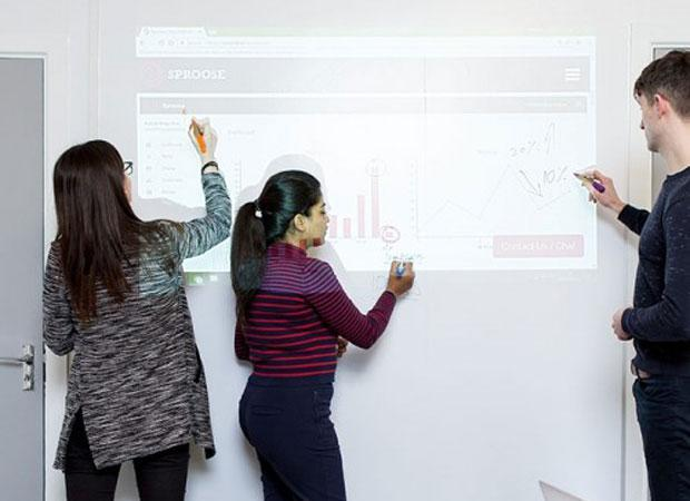 Simultaneously writing and projecting on Smart Whiteboard Wallpaper Low Sheen | smartersurfaces.sg