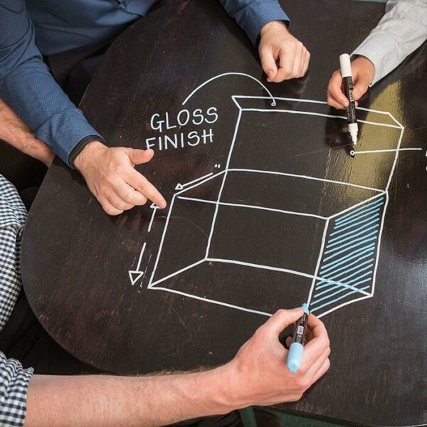 product 5 5 smart wall paint being used to design packaging on black desk | smartersurfaces.sg