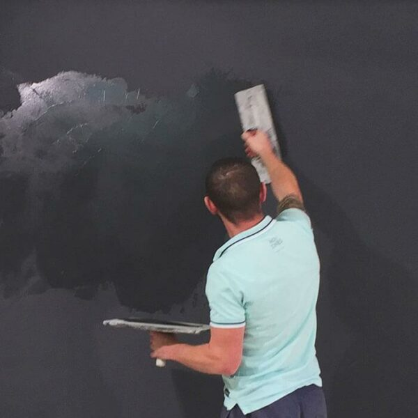 product c o contractor applying magnetic plaster to wall   smartersurfaces.sg