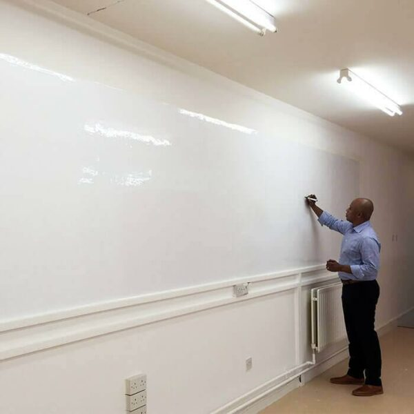 product m a man writing on glossy surface of smart whiteboard wallpaper | smartersurfaces.sg