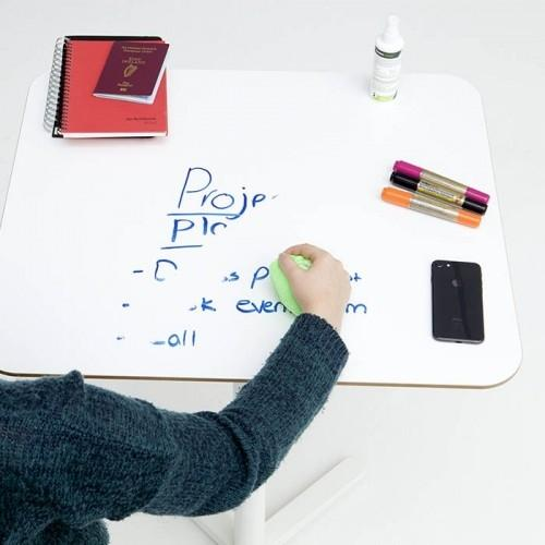 product s m smart self adhesive whiteboard film creates writable desk which is being erased using cloth   smartersurfaces.sg