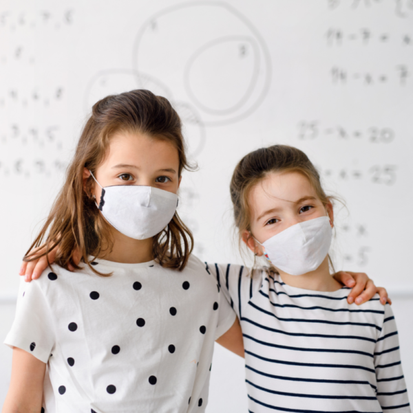 two children standing infront of Smart Antimicrobial whiteboard paint 800x801 1 | smartersurfaces.sg